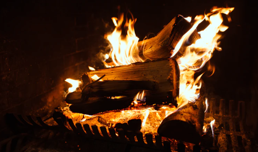 learning to build a fire in a fireplace like this beautiful log blaze